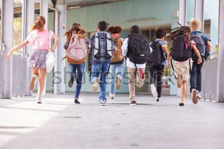 stock-photo-group-of-elementary-school-kids-running-at-school-back-view-388660693-e1520019346875.jpg